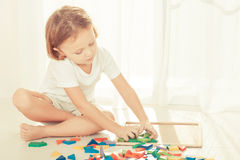 Little boy playing with wooden mosaic Stock Photography