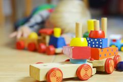 Little boy is playing with wooden train Royalty Free Stock Photos