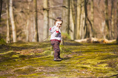 A little boy playing in the woods. Stock Images