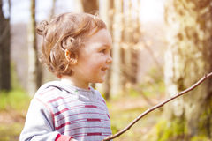 A little boy playing in the woods. Royalty Free Stock Photo