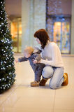 Little boy playing with xmas tree Royalty Free Stock Images