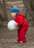 Little boy plays with ball Royalty Free Stock Images