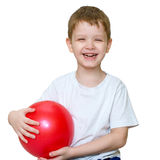 A little boy plays a ball and laughing Royalty Free Stock Photography