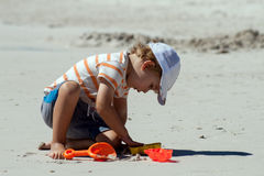 A little boy plays on a beach Royalty Free Stock Photography