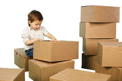 Little boy plays in boxes Stock Photography