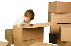 Little boy plays in boxes Royalty Free Stock Images