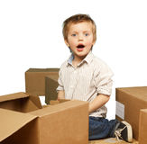 Little boy plays in boxes Royalty Free Stock Image