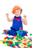 Little boy plays with bricks Stock Photography