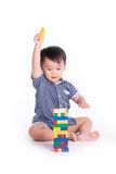 Little boy plays with bricks Stock Photo