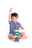 Little boy plays with bricks Stock Photo