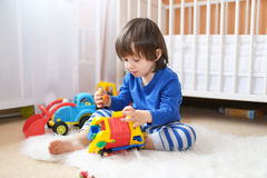 Little boy plays cars Royalty Free Stock Photography
