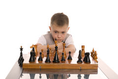 Little boy plays chess Stock Image