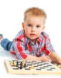 Little boy plays chess. Stock Photo