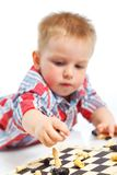 Little boy plays chess. Royalty Free Stock Image