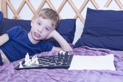 A little boy plays chess. royalty free stock photos
