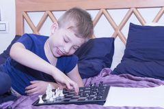 A little boy plays chess. royalty free stock photography