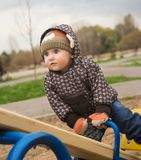Little boy plays childrens playground Stock Images