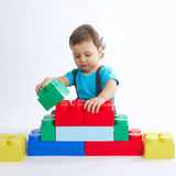 Little boy plays with colorful cubes Royalty Free Stock Photos
