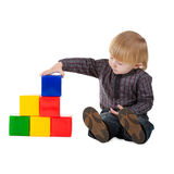 Little boy plays with colorful cubes isolated Royalty Free Stock Image