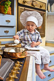 Little boy  plays the cook Stock Photography
