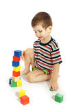 The little boy plays with cubes Royalty Free Stock Image