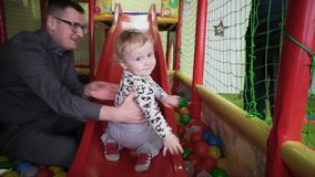 Cute little boy plays with dad in the playing room stock video footage