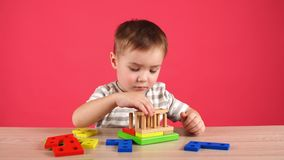 Little boy plays in developing game, education and daycare concept. Little boy plays in developing game, education and daycare concept stock footage