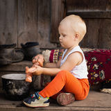 The little boy plays with a doll Stock Images