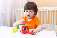 Little boy plays educational toy Stock Images