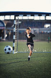 Little boy plays football Royalty Free Stock Images