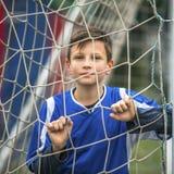 Little boy plays football on stadium. Sport. Stock Images