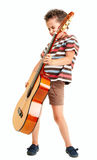Little boy plays guitar riff Stock Images