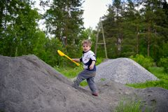 Little boy plays on heap of crushed stone Stock Photography