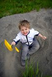 Little boy plays on heap of crushed stone Royalty Free Stock Photos