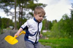 Little boy plays on heap of crushed stone Royalty Free Stock Photography