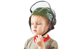 Little boy plays with helmet Stock Images