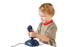 Little boy plays with a joystick Stock Photography