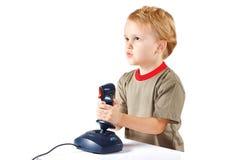 Little boy plays with a joystick Stock Photo