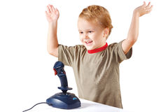 Little boy plays with a joystick Stock Photo