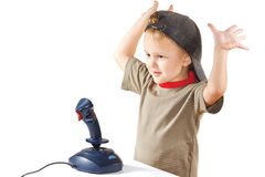 Little boy plays with a joystick Stock Images