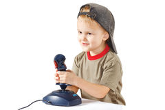 Little boy plays with a joystick Stock Image