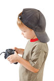 Little boy plays with a joystick royalty free stock images