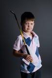 Little boy plays mini golf Stock Photo