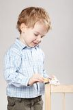 Little boy plays with mouse Royalty Free Stock Photos