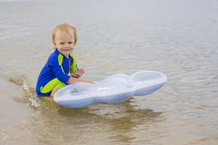 Little boy plays near water Royalty Free Stock Photos