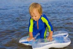 Little boy plays near water Stock Photo