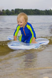 The little boy plays near water Stock Image