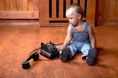 The little boy plays old phone Stock Photos