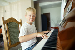 Little boy plays piano Royalty Free Stock Photos