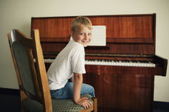 Little boy plays piano. Little funny boy plays piano Stock Image